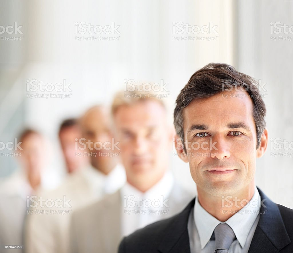 Older businessman with coworkers in line royalty-free stock photo