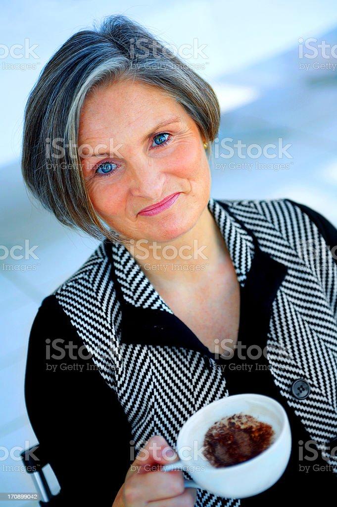 Older Businesswoman Enjoying Coffee royalty-free stock photo