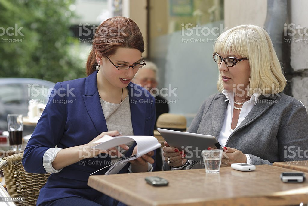 Older Businesswoman Mentoring Colleague royalty-free stock photo