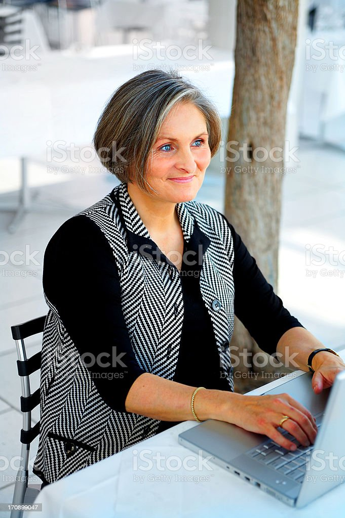 Older Businesswoman with her Laptop royalty-free stock photo