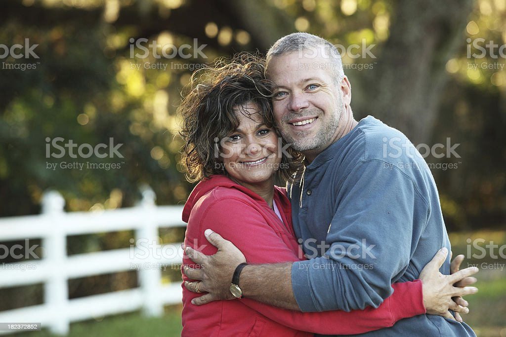 Older couple embracing royalty-free stock photo