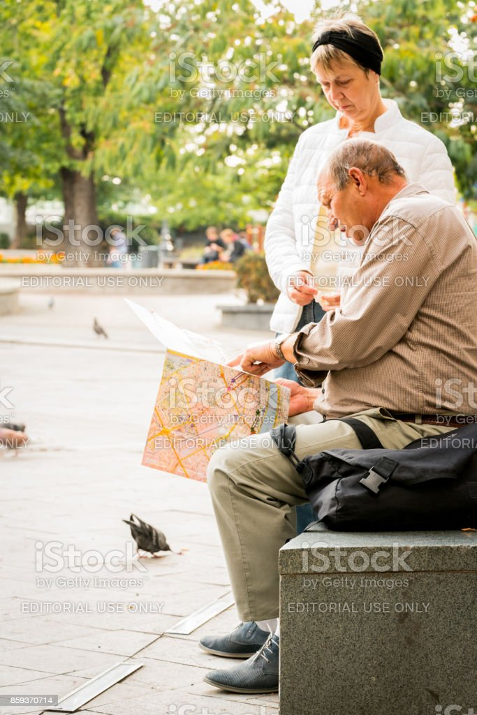 Older couple looking at a city map to find direction in Budapest. royalty-free stock photo