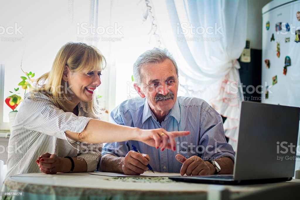 Older couple plans stock photo