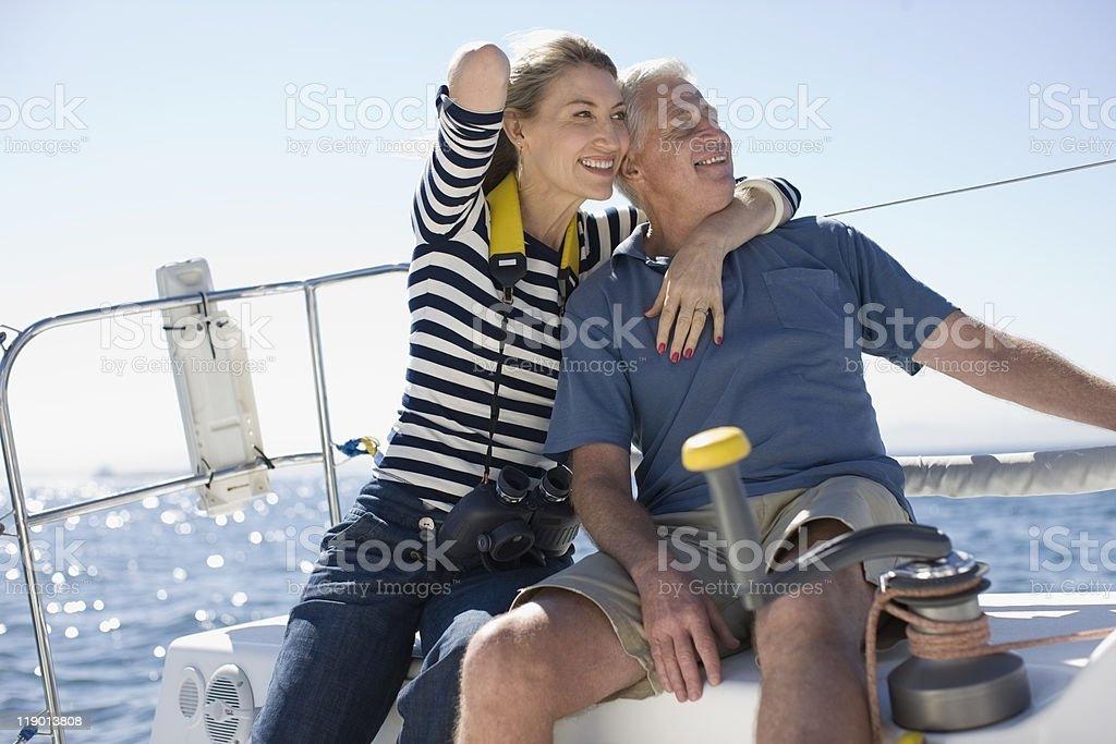 Older couple sitting on boat stock photo