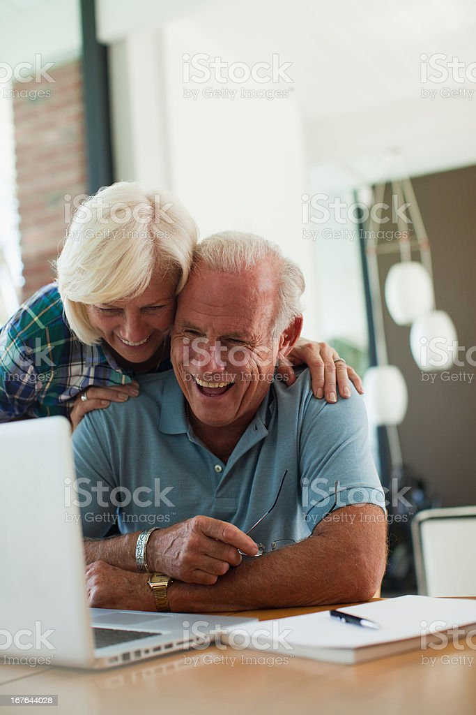 Older couple using laptop together royalty-free stock photo