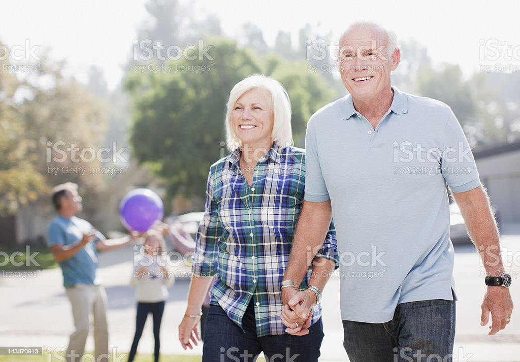 Older couple walking together outdoors royalty-free stock photo