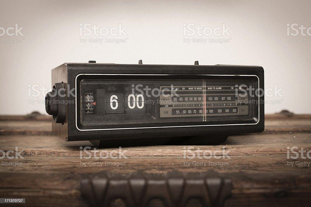 Older Digital Clock Radio Sitting on Wood Table stock photo