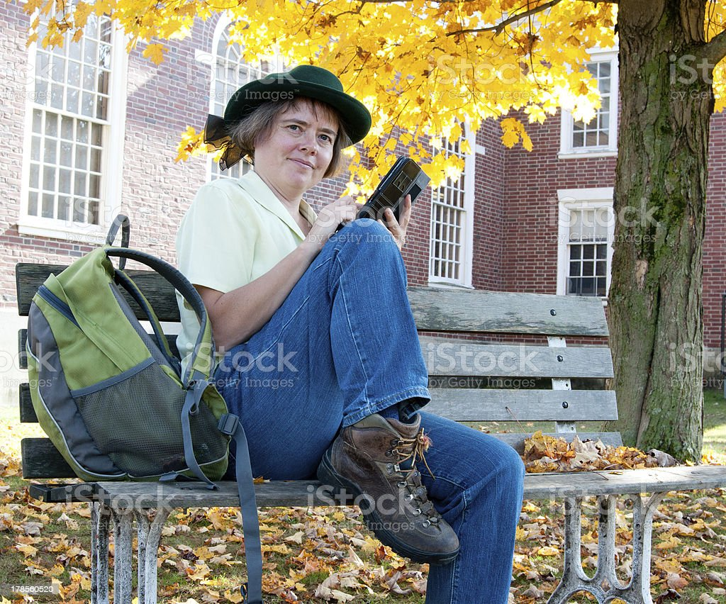 Older female student using a tablet computer on campus royalty-free stock photo