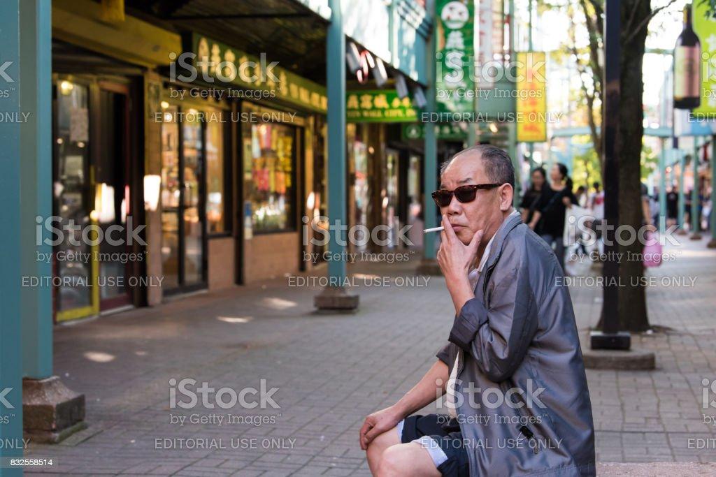 Older gentleman enjoying the evening in Chicago's Chinatown stock photo