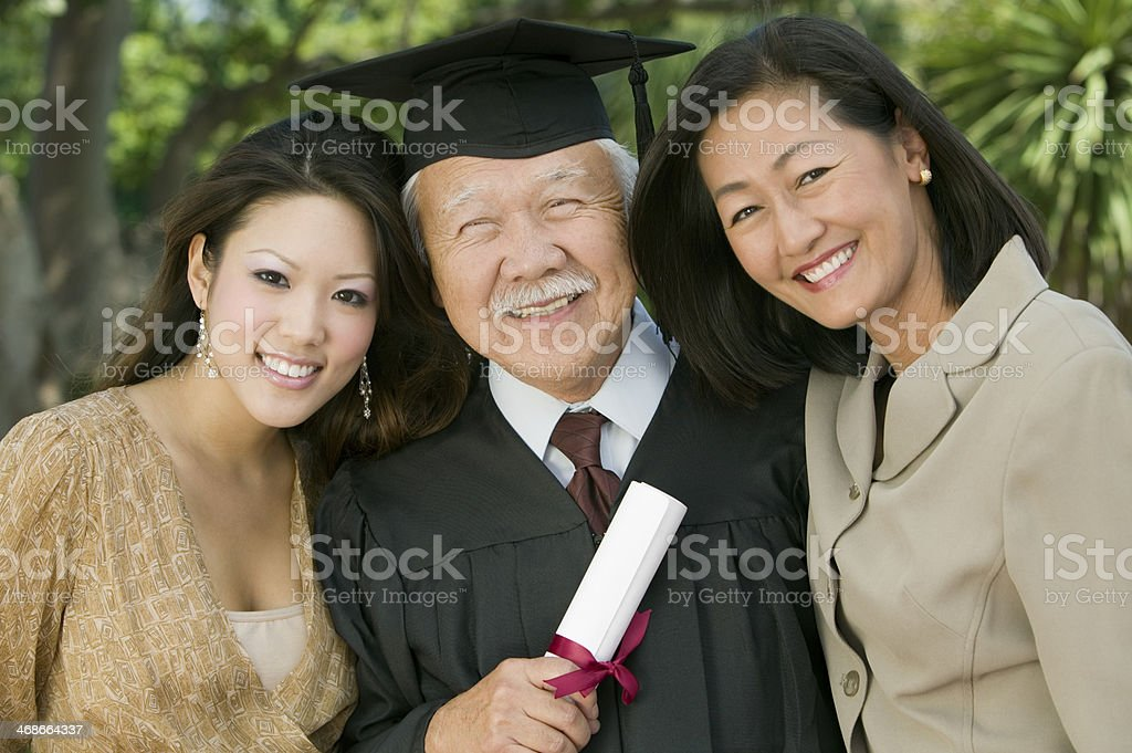 Older Graduate with Family stock photo