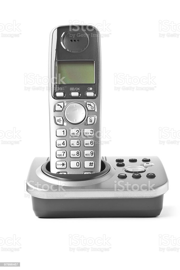 Older gray office telephone in dock royalty-free stock photo