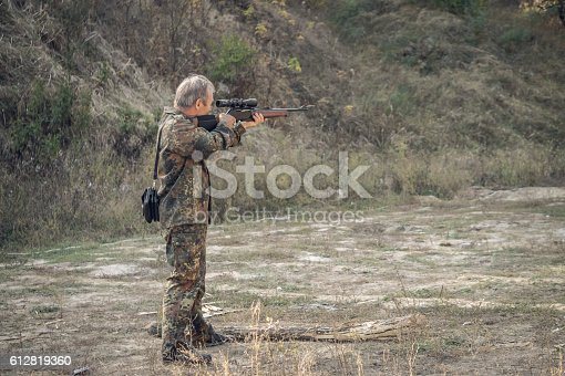658114236 istock photo Older hunter with a hunting rifle 612819360