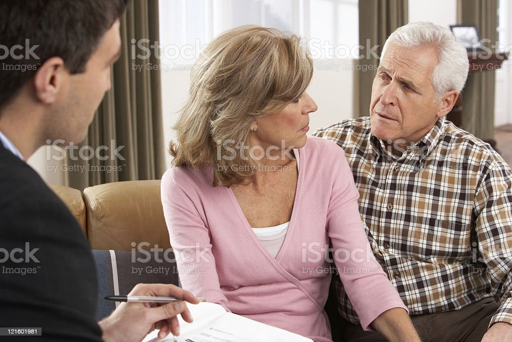 Older Husband And Wife Meeting With A Financial Advisor -8038