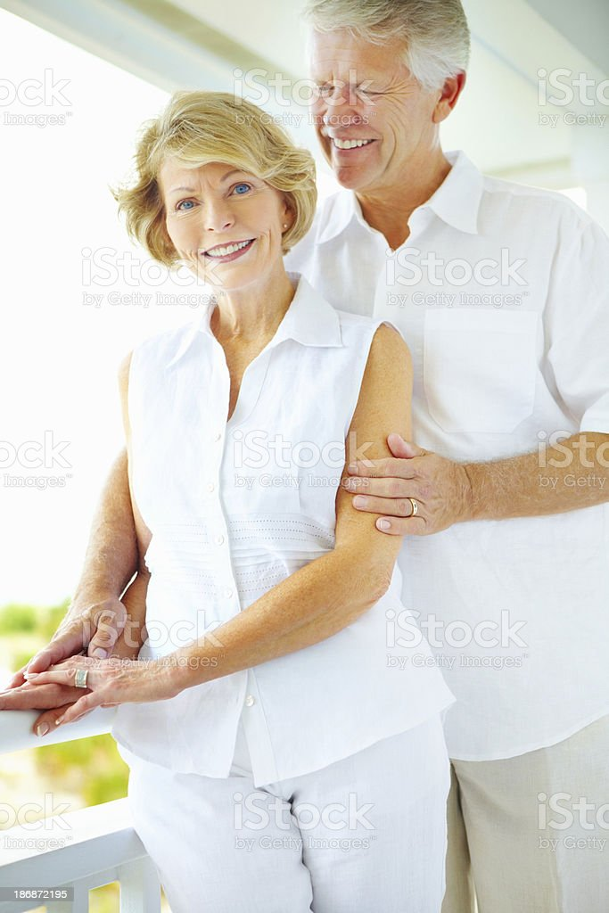Older man affectionately looking at his wife royalty-free stock photo