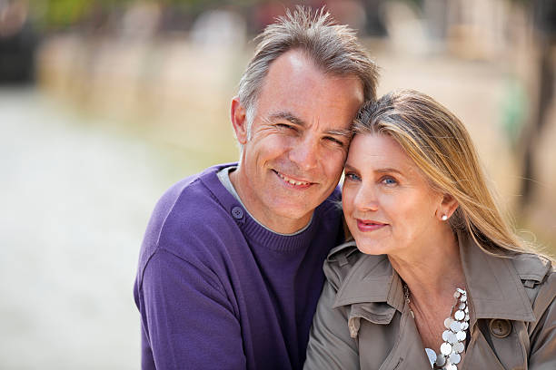 Older man and woman outside and smiling stock photo