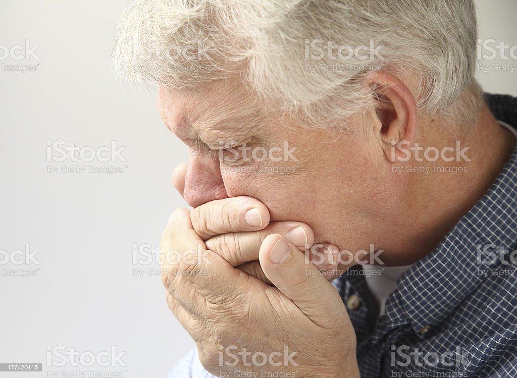 older man feels nausea stock photo