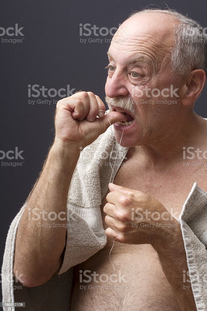 Older Man Flossing royalty-free stock photo