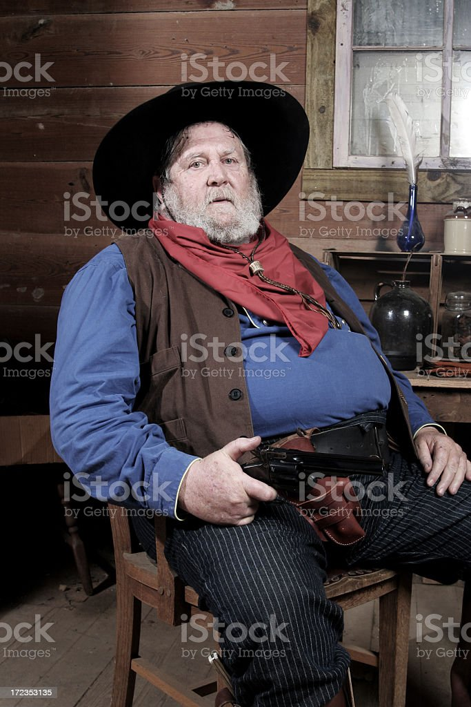Older Man holding a gun stock photo