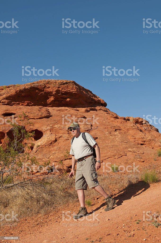 Older man on a hike in Utah - II stock photo