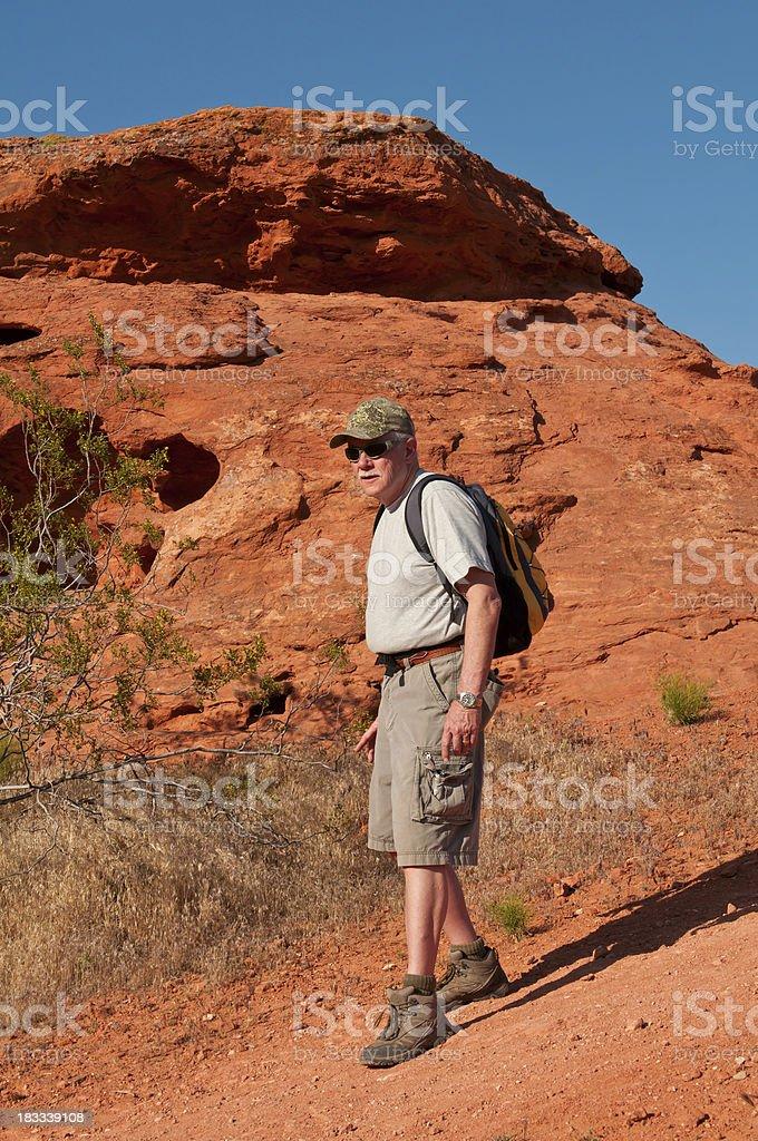 Older man on a hike in Utah - III stock photo