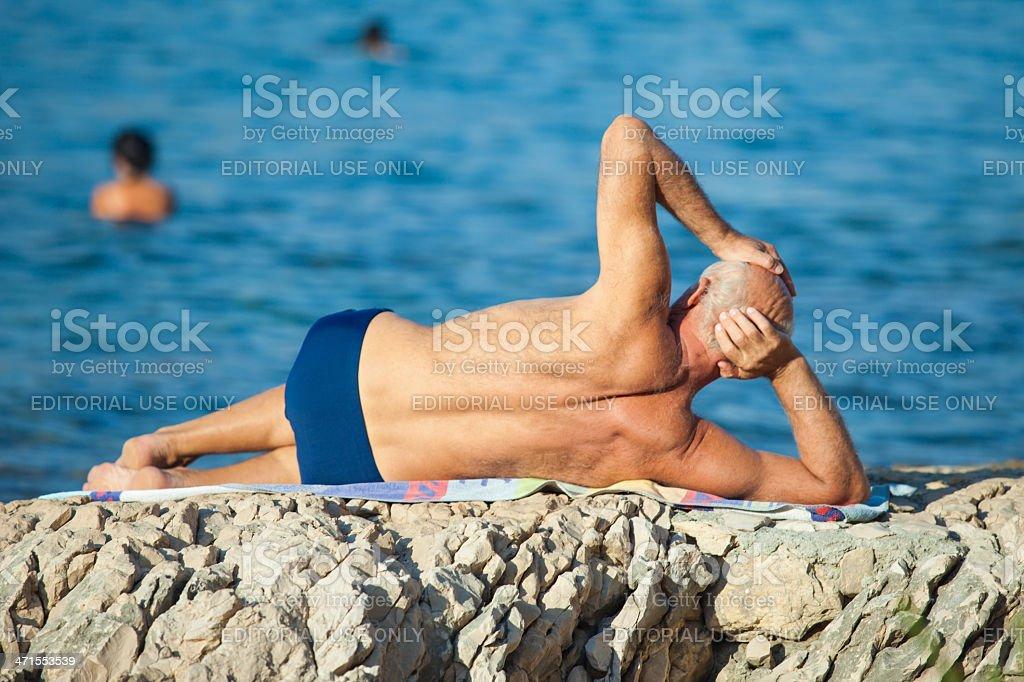 Older man on the beach royalty-free stock photo