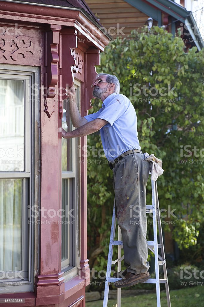 Older Man Painting His House stock photo