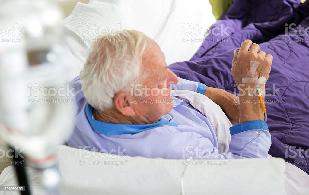 Older man receives infusion stock photo