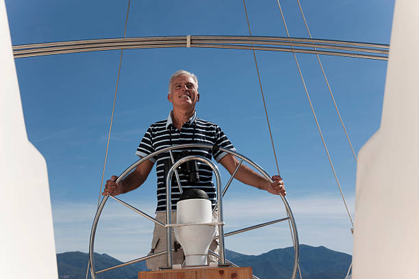 older man sailing - yacht front view stock photos and pictures