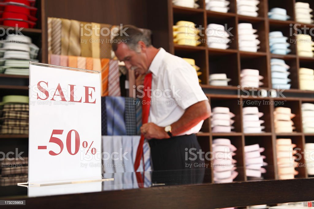 Older man shopping for a tie royalty-free stock photo