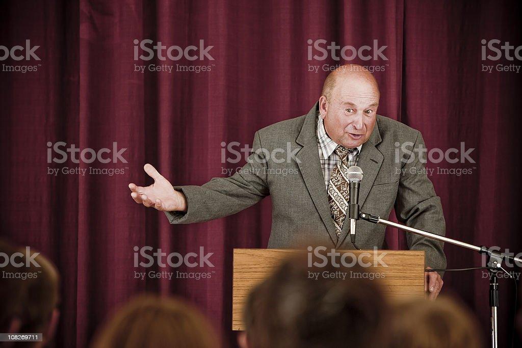 Older Man Speaking to Crowd stock photo