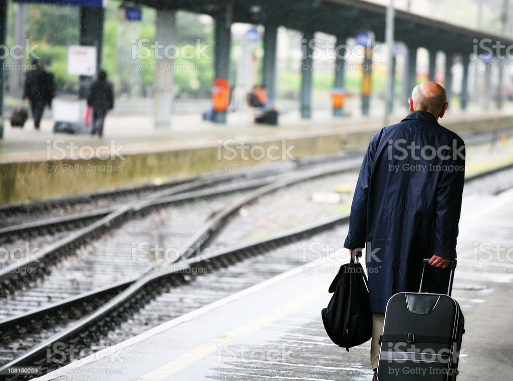 Older Man Travelling and Waiting for Train royalty-free stock photo