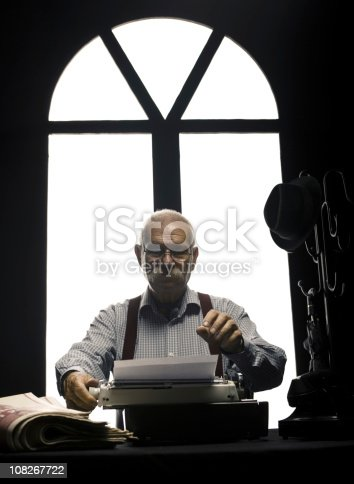 Old style journalist with type writer.