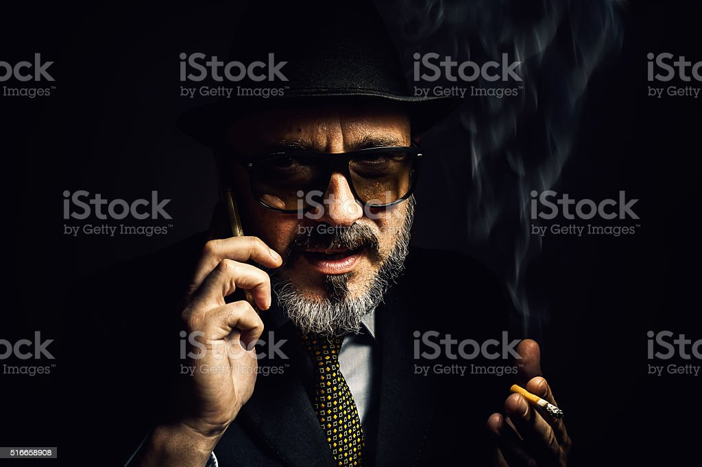 Older Man With Cellphone And Cigar stock photo