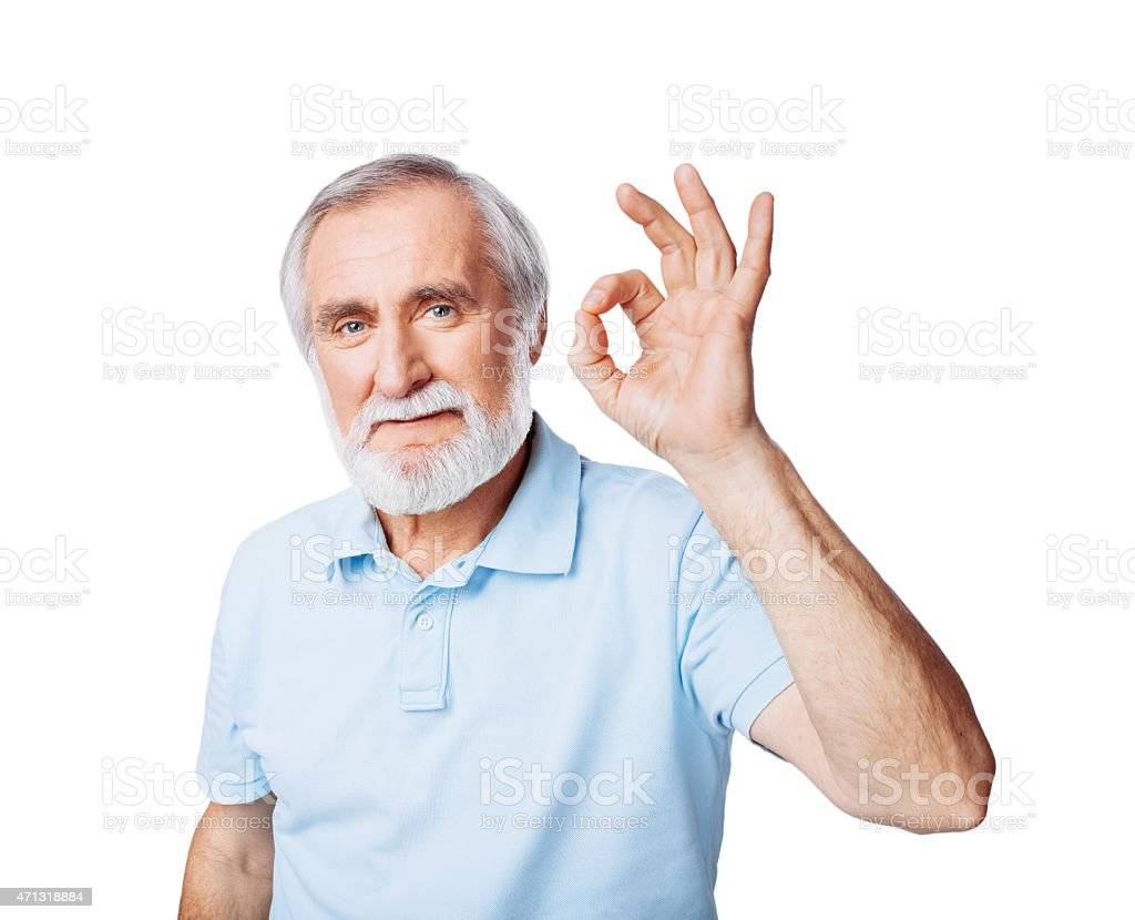Older man with gray beard giving the OK sign on white stock photo