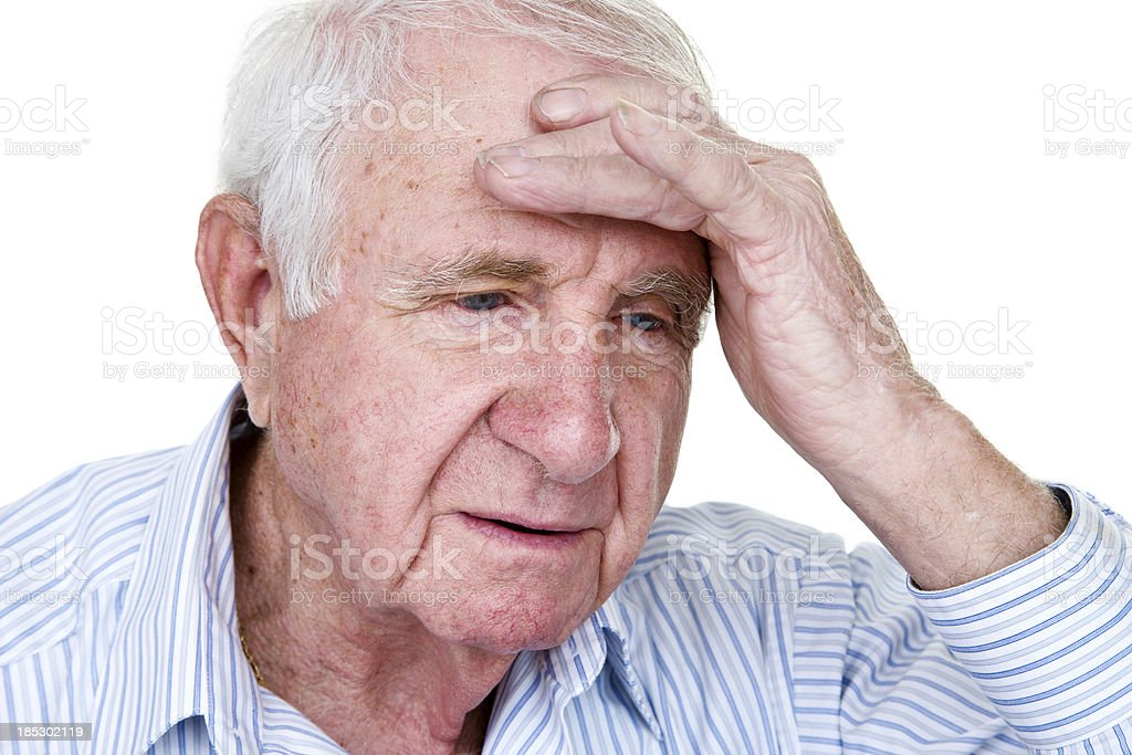 Older man with headache or depression royalty-free stock photo