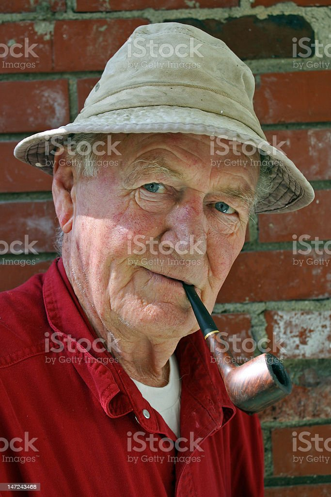 older man with pipe stock photo