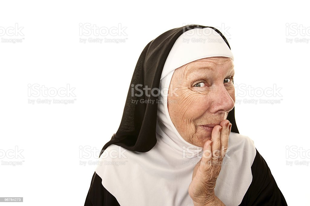Older nun holding in a laugh with her hand stock photo