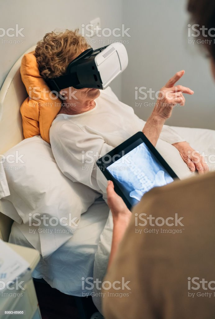 Older patient using virtual reality glasses stock photo