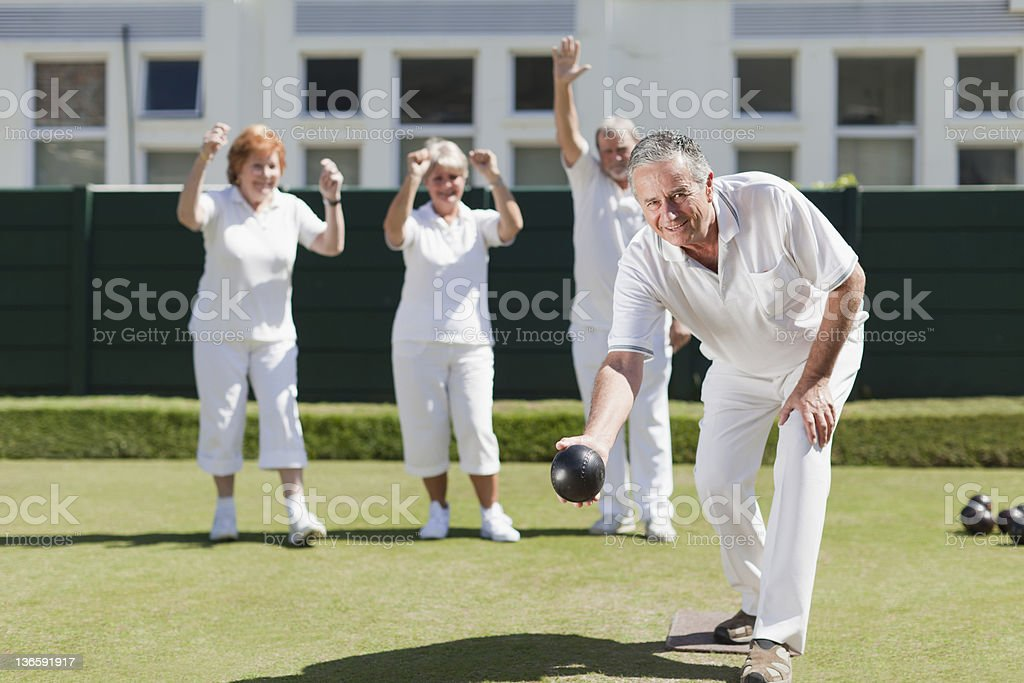 Older people playing lawn bowling royalty-free stock photo