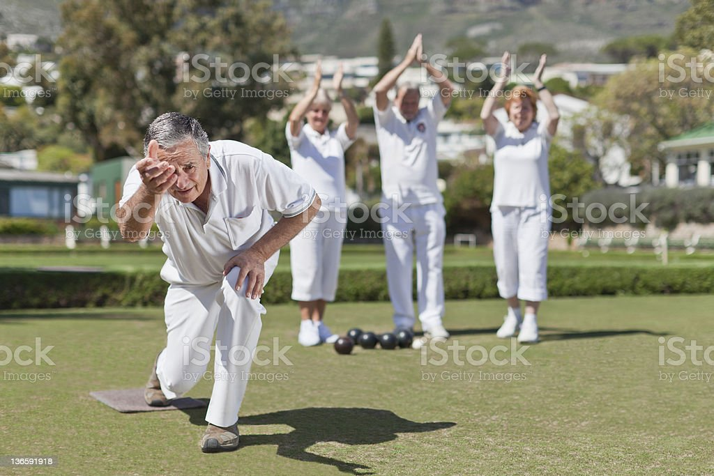 Older people playing lawn bowling stock photo
