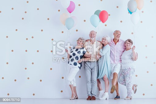 istock Older people with balloons 909475710