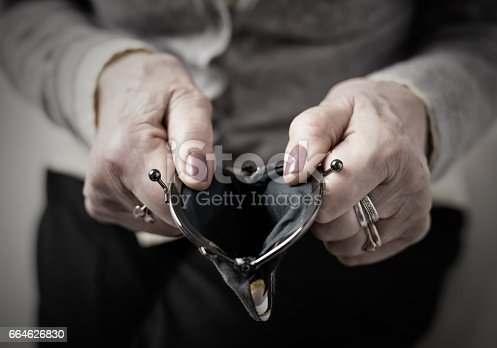 istock Older person holding money wallet open 664626830