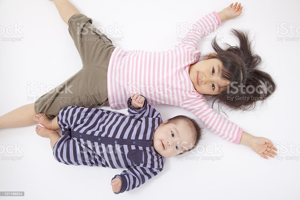 older sister and the younger brother who lie stock photo
