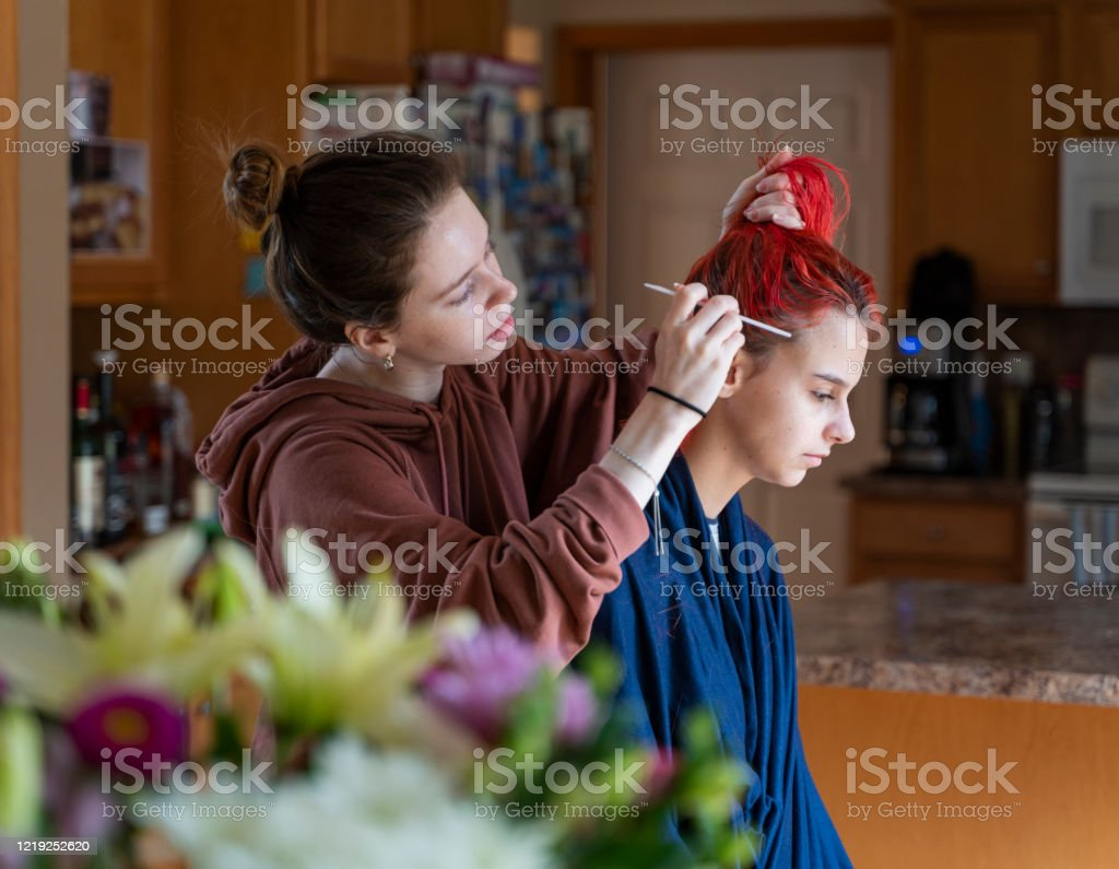 Older Sister Cutting Her Younger Sisters Hair In The Kitchen Stock Photo -  Download Image Now