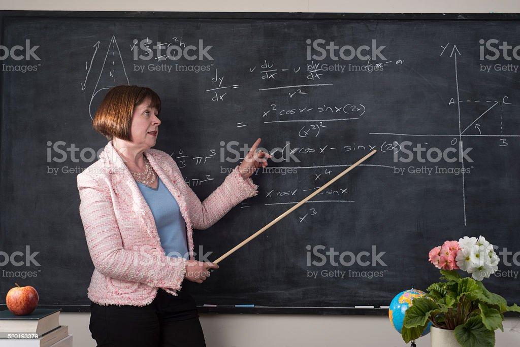 Older teacher explaing maths stock photo