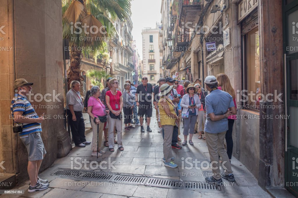 Older tourists in a group in El Born, Barcelona stock photo