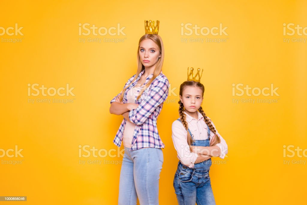 Older vs younger siblings! Who is parents best favorite blue-eyed girl?Bad behavior denim jeans outfit  concept. Portrait of confident narcissistic beautiful girls isolated on bright background stock photo
