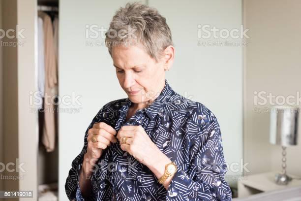 Older woman getting dressed in bedroom picture id861419018?b=1&k=6&m=861419018&s=612x612&h=xdgzy1nyjyvns5j3azrshukb5e pc eyssh 3ebxx2o=