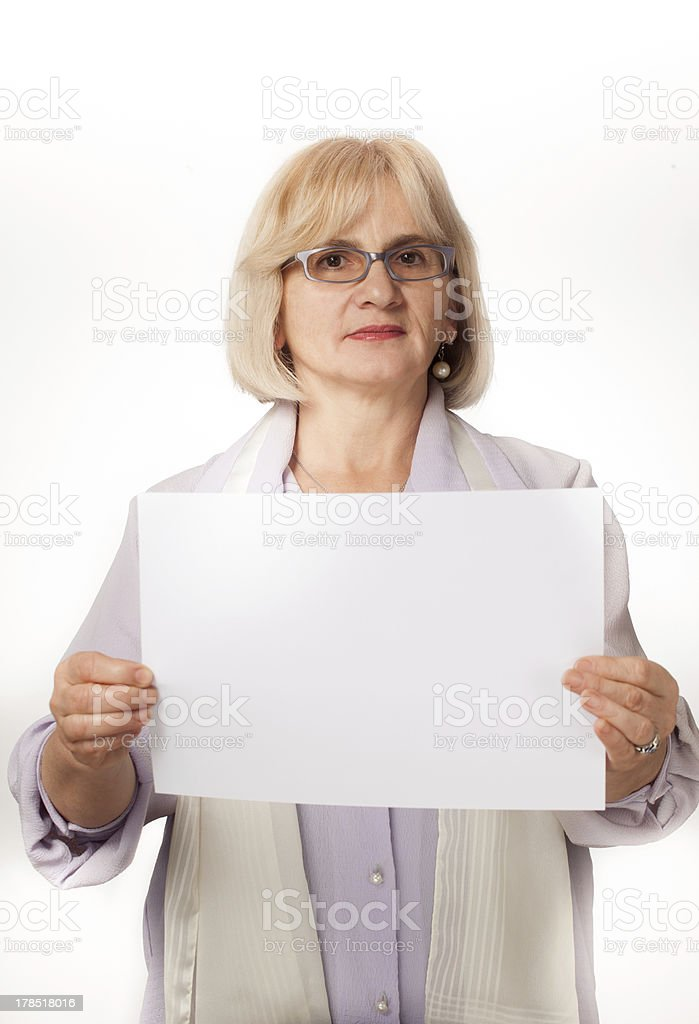 Older woman holding white cardboard royalty-free stock photo