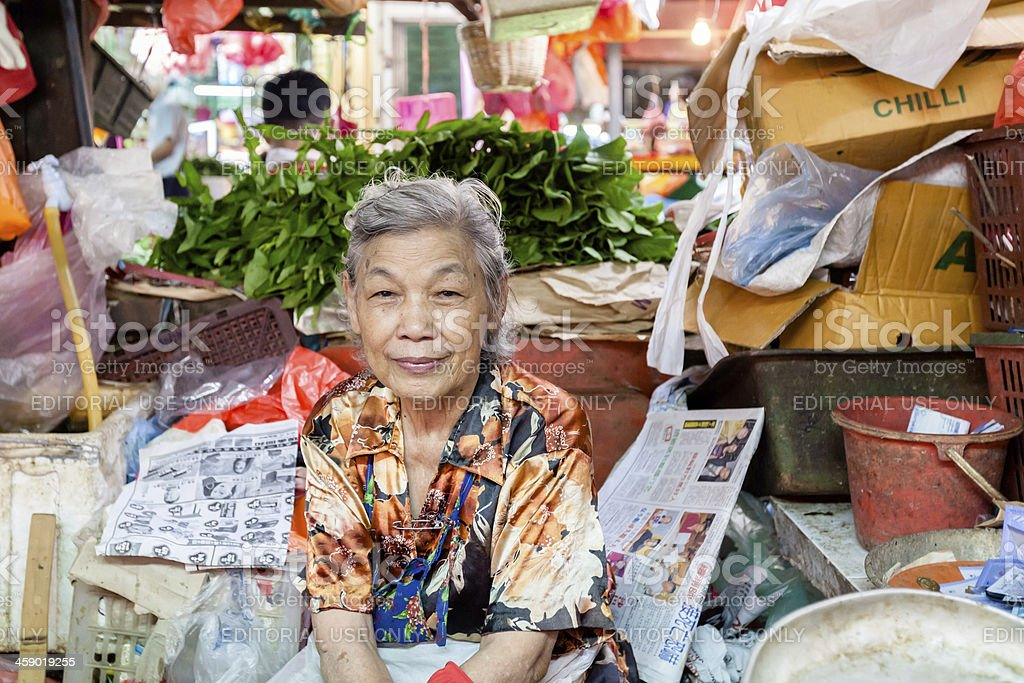 Older Woman in Asian Marketplace royalty-free stock photo